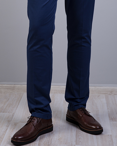 A pair of slim-fit navy chinos